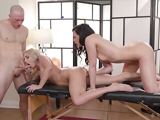 Masseur has joke with coworker Whitney Wright and client Christie Stevens