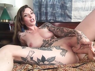 Tattooed solely girl Penny Archer enjoys bringing off with a spacious toy