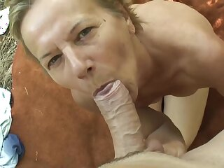 Hungarian mature is sucking a rock hard dick in the forest and getting it inside her pussy